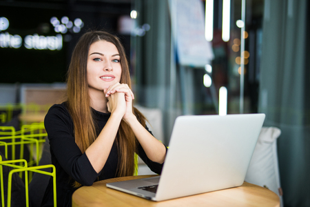 hubs: Working woman at smart space in modern office