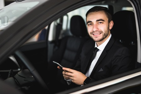 Portrait handsome business man use phone in car Stock Photo