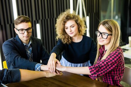 teambuilding: Teamwork concept. United hands of business team