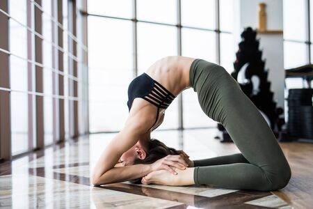 hasta: Beautiful yoga woman practice near window yoga room studio background. Yoga concept.