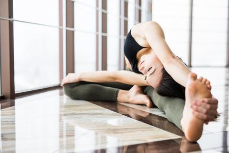 ardha: Beautiful yoga woman practice near window yoga room studio background. Yoga concept.