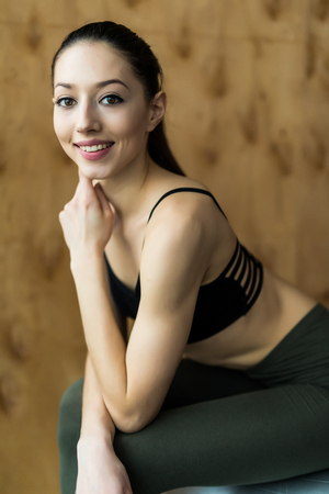 laying abs exercise: fitness, sport, training, gym concept - young woman doing exercise on fitness ball