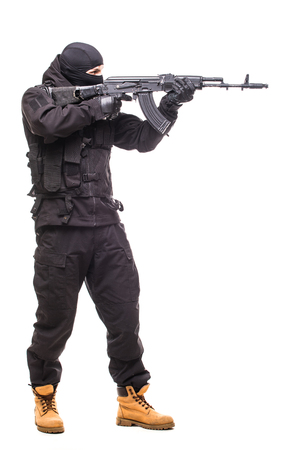 Terrorist with weapon on a white background Stock Photo
