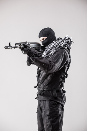 bombing: Military, war, conflict, soldiers - Special forces soldier man hold Machine gun on a grey background