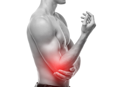 Elbow pain is often caused by overuse. Sports, hobbies and jobs require repetitive hand, wrist or arm movements. Stock Photo