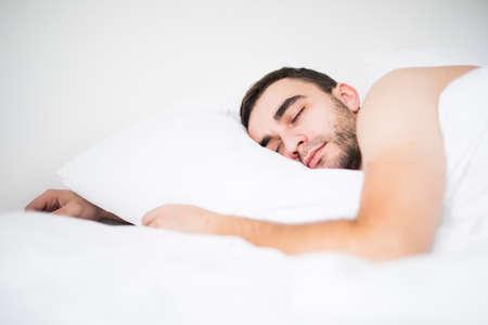 wellness sleepy: Young Man Sleeping On Bed In Bedroom