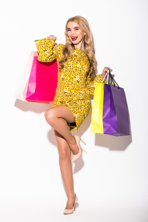 Portrait of an young woman holding several shoppingbag Stock Photo
