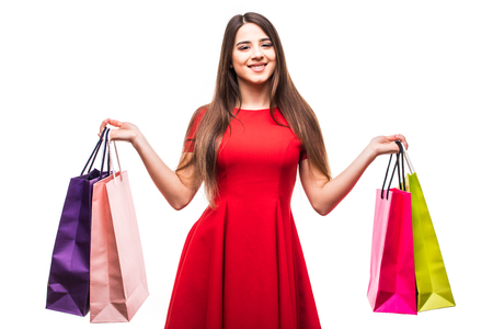 Beautiful smile woman with color shoping bags on white background