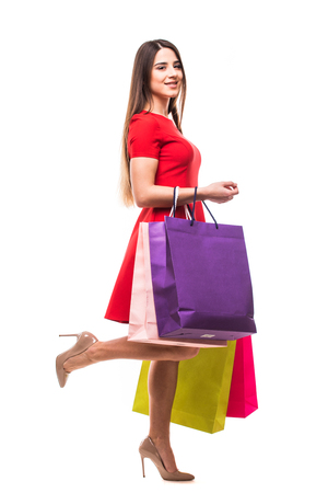 Young woman with bags, shopping concept, isolated on white background Stock Photo