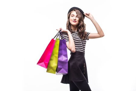 cutouts: Portrait of young happy smiling woman with shopping bags, isolated over white background