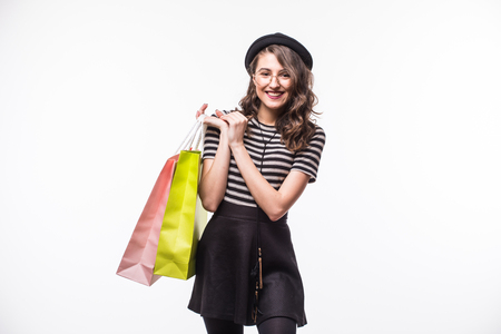 Shopping woman holding bags, isolated on white studio background Stock Photo