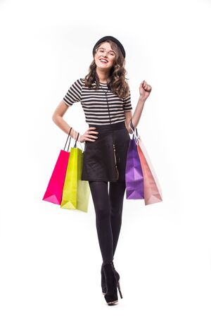 Full length shot of an attractive young woman holding paper shopping bags