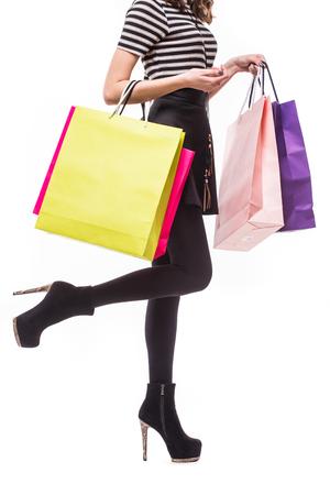 Shopping woman holding shopping bags. Closeup of beautiful women colorful shopping bags.