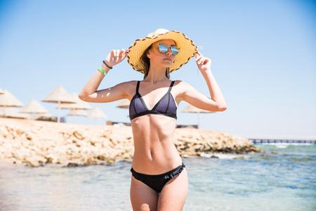 Beautiful young woman at the beach sea