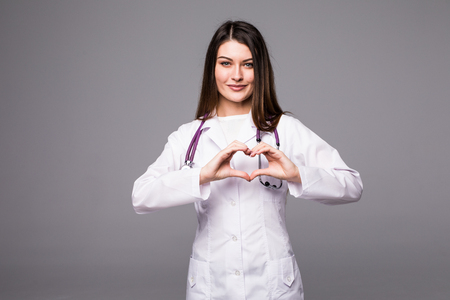 heart shaped: Closeup on medical doctor woman showing heart shape gesture