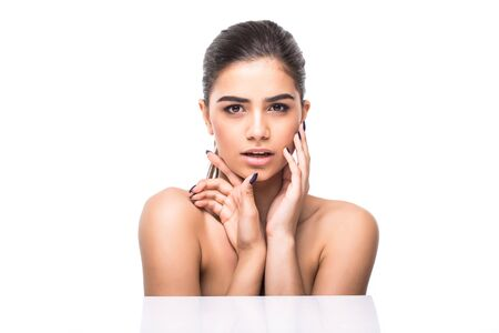 Beautiful Young Woman with Clean Fresh Skin touch own face