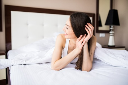 drowsy: beautiful girl sleeps in the bedroom at home