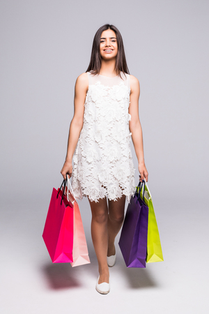 Beauty Girl bending with bags after shopping Stock Photo