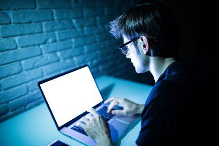 Man using laptop writing programming code on laptop Stock fotó