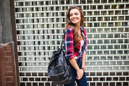 Summer sunny lifestyle fashion portrait of young stylish hipster woman walking