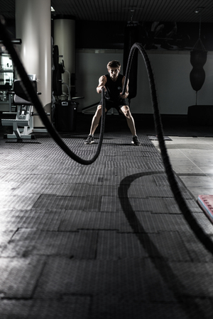 Crossfit battling ropes at gym workout exercise 스톡 콘텐츠
