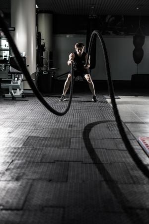 Crossfit battling ropes at gym workout exercise Banque d'images