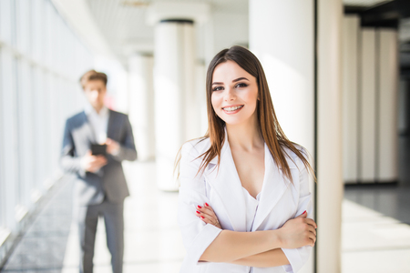 Attractive business woman in front of business man. Business team