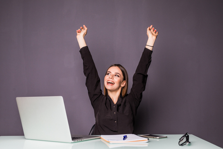 Young happy attractive woman at modern office desk, with laptop feeling great things on career horizon, saying yes to new adventures, cheerful good morning news, working toward success and reached it