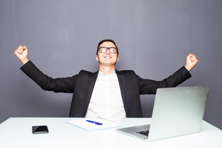 Happy man completed task and triumphing with raised hands