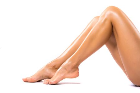 Beautiful female legs after depilation. isolated on white background