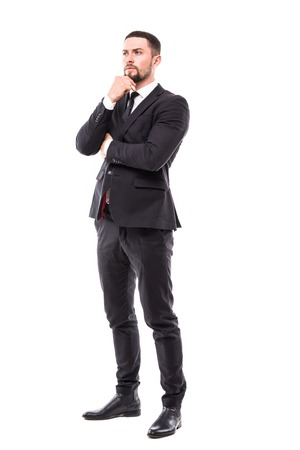 full body picture of a smiling young business man holding his chin and thinking , side view picture on white background