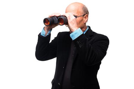 Handsome man viewing through binoculars on white background Stock Photo