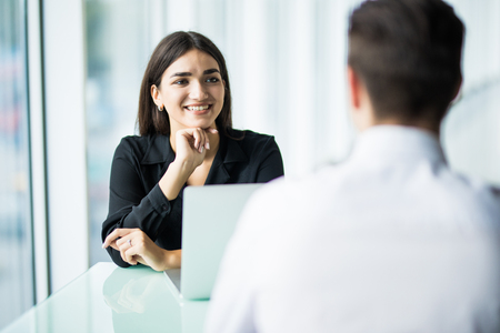 Coworkers talking in the office. Business partners in the office, Stock Photo