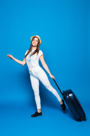 Fashionable woman running with suitcase on blue background Stok Fotoğraf - 90416520