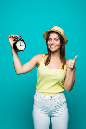 Smiling Business woman holding alarm watch. Isolated portrait.