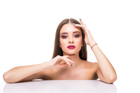 beauty, people and bodycare concept -beautiful young woman face and hands on white background Stock Photo