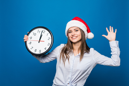 Happy smile Woman with clock shows 12 oclock New Year party begin on blue background