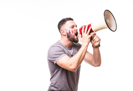 Scream on megaphone France football fan in game supporting of France national team on white background. Football fans Archivio Fotografico