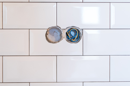 Stylish trendy white ceramic tile with a chamfer on the kitchen wall.
