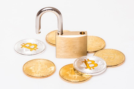 Many bitcoins with a open lock isolated white