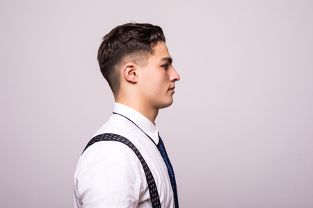 Side view portrait of confident man with beautiful hairstyle in white shirt looking on copy space Stock Photo