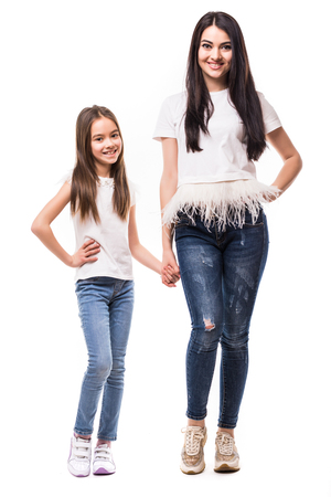 mother and little daughter full length portrait on white Zdjęcie Seryjne