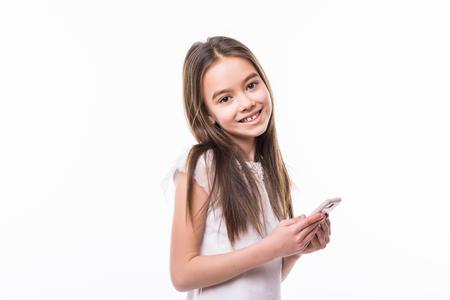 Little girl holding a smart phone against white Zdjęcie Seryjne