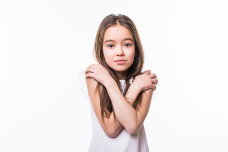 young girl with funny expression shrugged shoulders Stock Photo