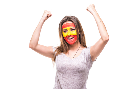 Pretty woman supporter fan of Spain national team painted flag face get happy victory screaming into a camera.