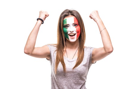 Pretty woman supporter fan of Mexico national team painted flag face get happy victory screaming into a camera.