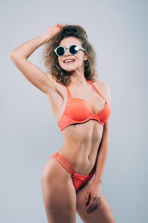 Attractive girl in a white bikini, sunglasses isolated Stock Photo