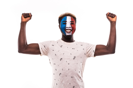 Happy victory scream fan support France national team with painted face isolated on white Stock Photo