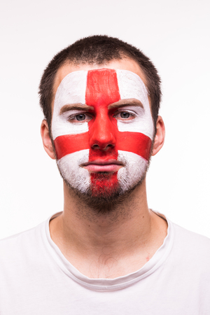 Face portrait of happy fan support England national team with painted face isolated on white