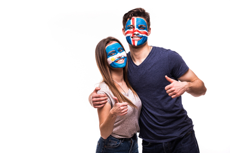 Football fans supporters with painted face of national teams of Argentina and Iceland isolated on white